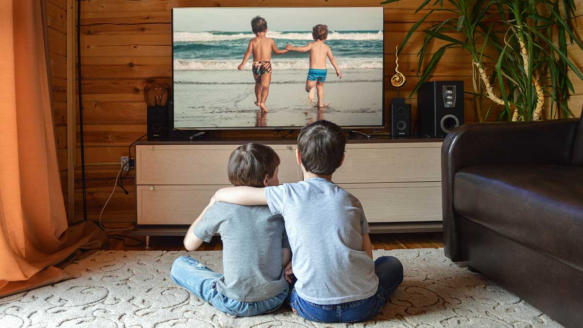 Boys watching home movies